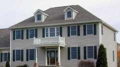 Чем четырехскатная крыша привлекательна при строительстве своего дома?