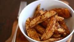 Как готовится картошка дольками, запеченная в духовке?