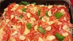 Мясо по-французски с сыром и помидорами в духовочном шкафу