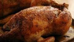При какой температуре запекать курицу в духовке целиком и кусочками