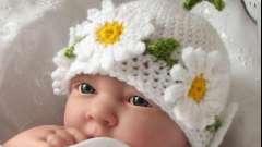 Шапочка зимняя для новорожденного: удобно и красиво