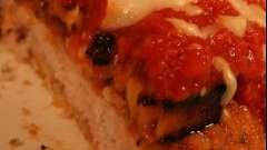Свинина с баклажанами и томатом под сырной шапкой